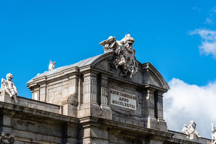 Puerta de Alcala in Madrid Puerta De Alcalá Sculpture Architecture Sky Statue Low Angle View Representation Human Representation Built Structure Art And Craft Building Exterior Nature Blue Travel Destinations Day Male Likeness The Past History Creativity Travel No People Outdoors Neoclassical Neoclassical Architecture Alcala Gate Travel
