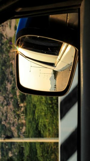 Glass - Material Reflection Transparent Close-up No People Mode Of Transportation Land Vehicle Car Focus On Foreground Day Mirror Motor Vehicle Side-view Mirror Window Outdoors Nature Sunlight Transportation Metal Tree