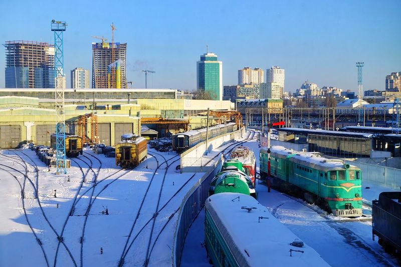 Kyiv-Pasazhyrskyi railway station, Kyiv, Ukraine. Transportation Outdoors Kyiv Kyiv,Ukraine Ukraine Ukraine 💙💛 Railroad Station Snow Sunny Sunny Day Morning Light Tourism Old And New Winter Bright Colors Building Exterior Built Structure Mode Of Transportation Cold Temperature Skyscraper Track Cityscape Train Railroad Station Platform Railroad Track City Architecture No People Industry Building Day Sky High Angle View