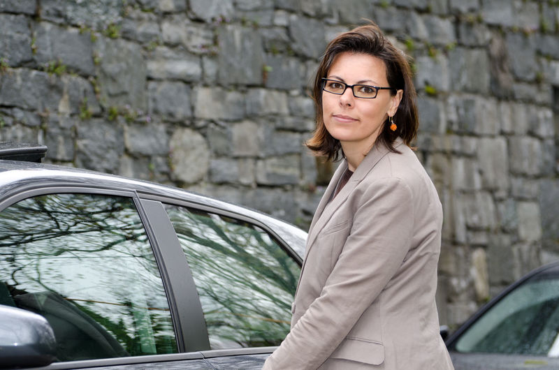 Woman and her car Adult Adults Only Business Finance And Industry Car Car Door Car Window Confidence  Day Door Elegance And Class Eyeglasses  Handle Lifestyles Looking At Camera One Person One Woman Only One Young Woman Only Only Women Outdoors People Portrait Reflection Standing Suit Young Adult