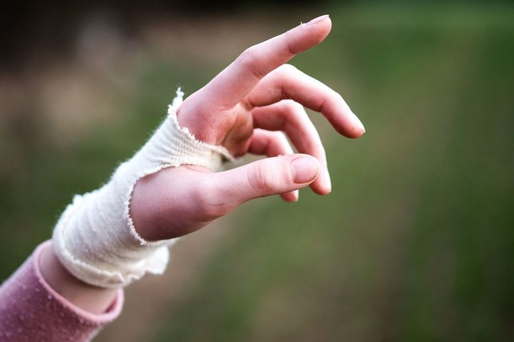 Close-up of woman hand with bandage