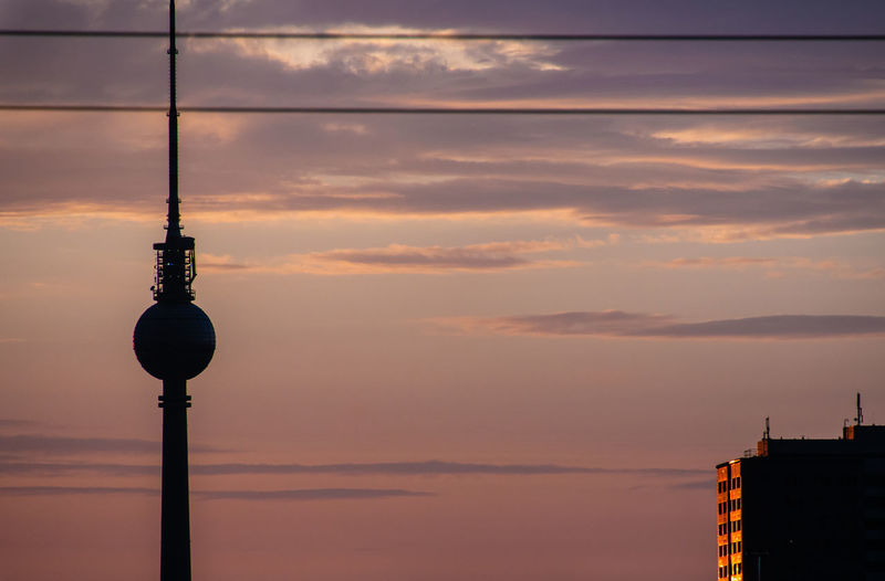 Silhouette Of Fernsehturm Tower Against Sky During Sunset