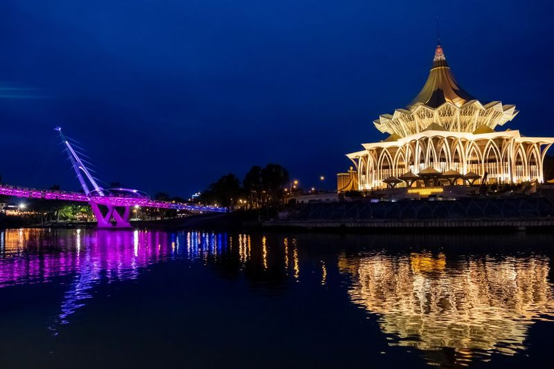 Beautiful view of Kuching Waterfront at night Illuminated Night Built Structure Building Exterior Architecture Water Sky Reflection Nature Travel Destinations No People Waterfront Travel River City Tourism Belief Religion