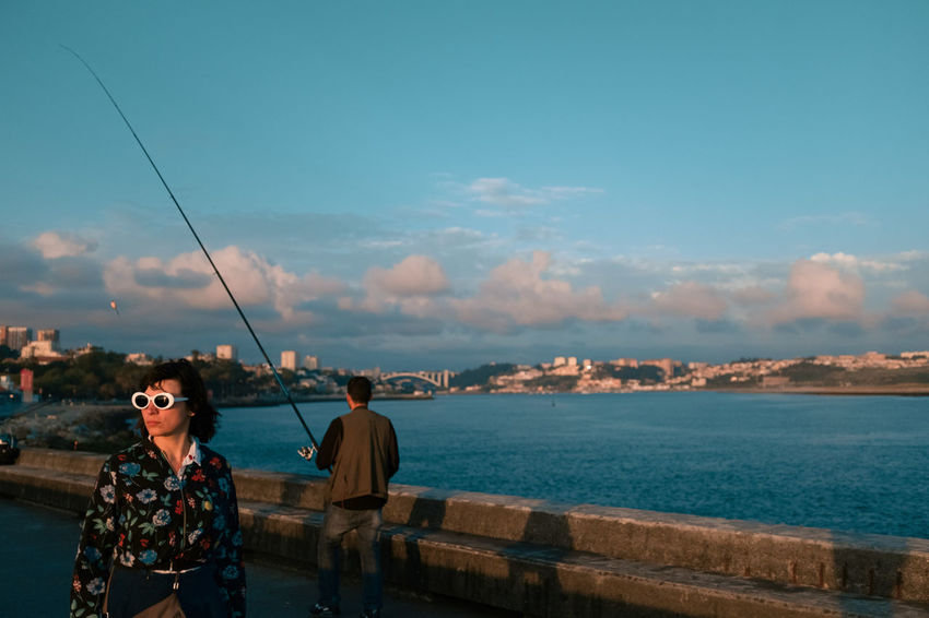 An evening in Porto Threeweeksgalicia Water Sky Sea Cloud - Sky Real People Lifestyles Nature Leisure Activity People Sunglasses Men Day Two People Beauty In Nature Glasses Standing Scenics - Nature Fishing Togetherness Outdoors Streetphotography