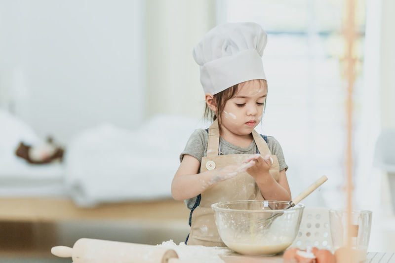 Girl looking away in bowl at home