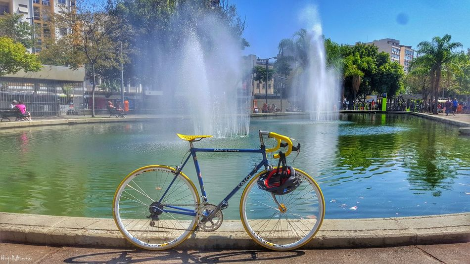 Water Motion Fountain Spraying Bicycle Splashing Mode Of Transport Transportation City Travel Land Vehicle Lens Flare Biker Life Day Sunbeam Bicycle Rack outdoors City Life Freshness Flowing Water Caloi12 Bikeporn Cycle Parked No People Caloi