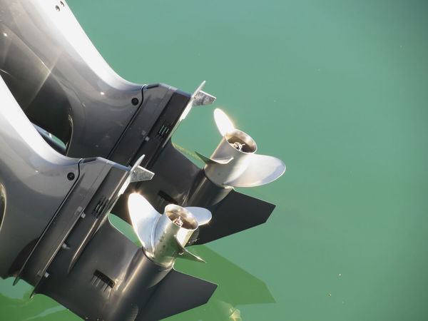 Two outboard boat motors tuned up and trying on the first run Boat Boating Detail Engine Equipment Fan Hull Luxury Marine Metal Motor Motorboat Motorized Nautical Outboard Piston Power Propeller Screw Speedboat Steel Transportation Turbine Vehicle Water