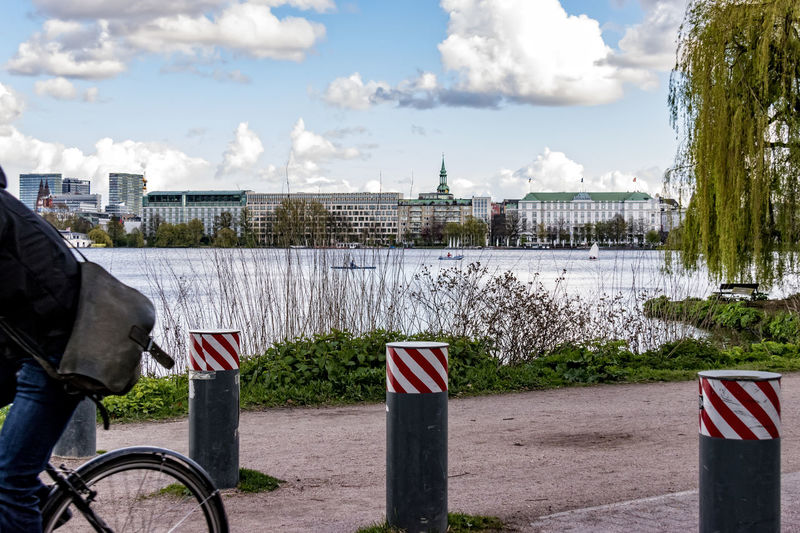 Hamburg Außenalster Außenalster Blue Sky And Clouds Bycicle Byker City Cityscape Day Daylight Hamburg Hotel Atlantic Man No People Outdoor Poller Sea Tree