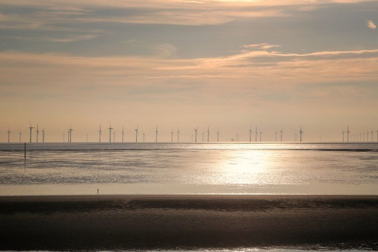 Crosby Beach Sky Scenics - Nature Water Beauty In Nature Sea Nature Crosby Beach Cloud - Sky Sunset Fuel And Power Generation Environment Environmental Conservation Wind Turbine No People Turbine Tranquility Outdoors Industry Renewable Energy Tranquil Scene Power Supply