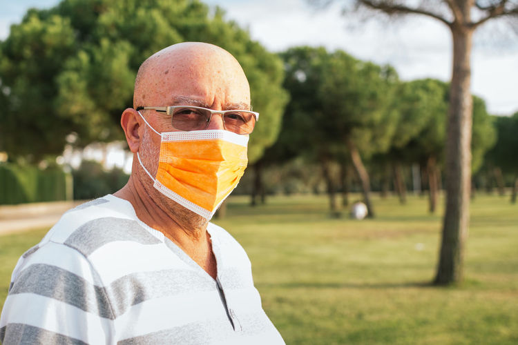 Portrait of 65-year-old man with surgical mask