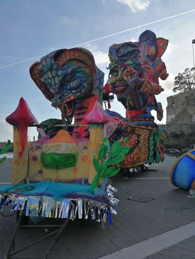 Maiori, Campania, Italy - March 4, 2019: Allegorical floats in the square of the port for the 46th edition of the Grand Carnival of Maiori Italy Campania Salerno Italy Grand Carnival Of Maiori Amalfi Coast Colorful Floats Carnival - Celebration Event Allegorical Floats Maiori, Day Multi Colored Art And Craft Creativity Sky Representation Sculpture Human Representation Statue Craft Cloud - Sky Outdoors Decoration Arts Culture And Entertainment Festival
