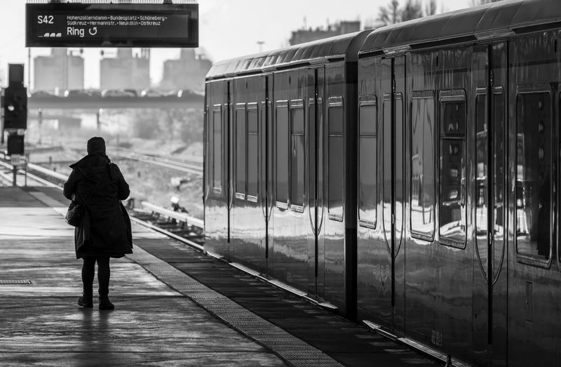 The Art Of Street Photography Black And White Street Photography City Silhouette S-bahn S-bahnhof Subway Subway Station Subway Train Rail Transportation Rear View Public Transportation Train Transportation Train - Vehicle Real People Railroad Station Railroad Station Platform One Person Mode Of Transportation Women Adult Travel Lifestyles Full Length Architecture Standing Day Outdoors Track Waiting