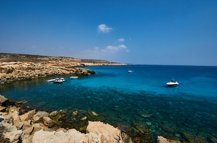 Cape Greco, Cyprus Cyprus Beach Beauty In Nature Blue Cape Greco Day Horizon Over Water Jet Boat Mode Of Transport Nature Nautical Vessel No People Outdoors Rock - Object Sailboat Sailing Sailing Ship Scenics Sea Sky Tranquil Scene Tranquility Transportation Travel Destinations Water Yacht