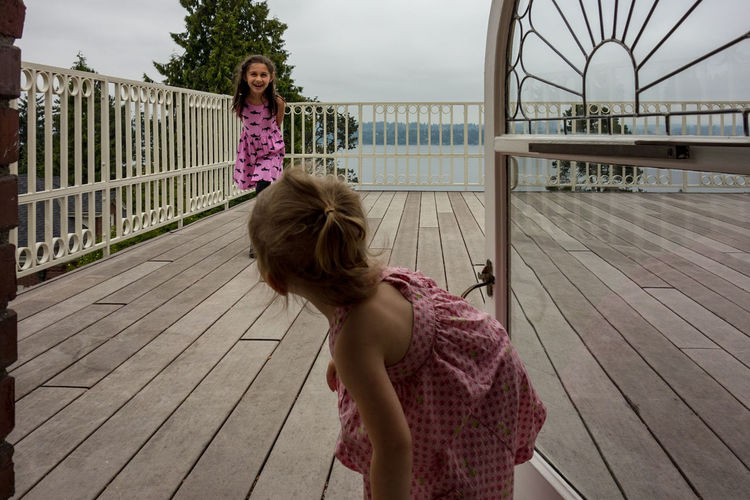 rooftop deck Laughing Kids Rooftop View Lake Washington Playing Child Water Childhood Females Girls Summer Standing Sky Deck Patio This Is Family