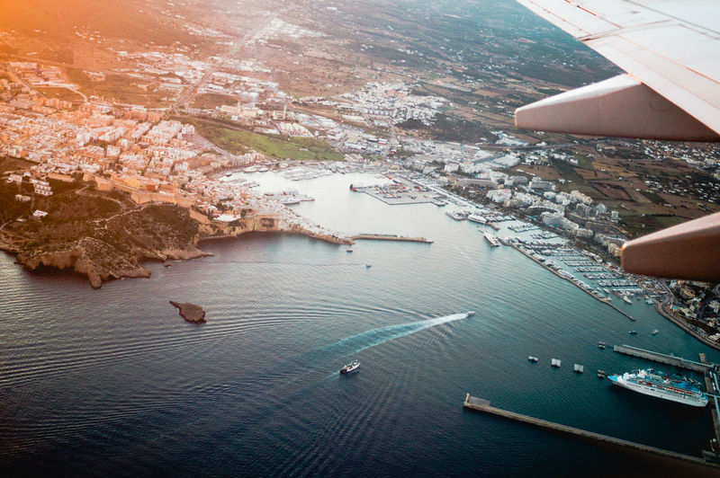 Ibiza at Sunset Aerial View Architecture Beauty In Nature City Cityscape Day EyeEm Best Shots EyeEm Selects Flying Human Body Part Ibiza Ibiza Beach Nature One Person Outdoors People Port Real People Scenics Sea Sun Sunset Transportation Water