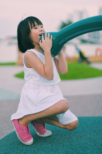 Close-up of girl playing in park