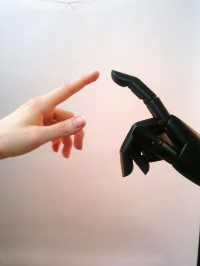 Close-up of hand by robot