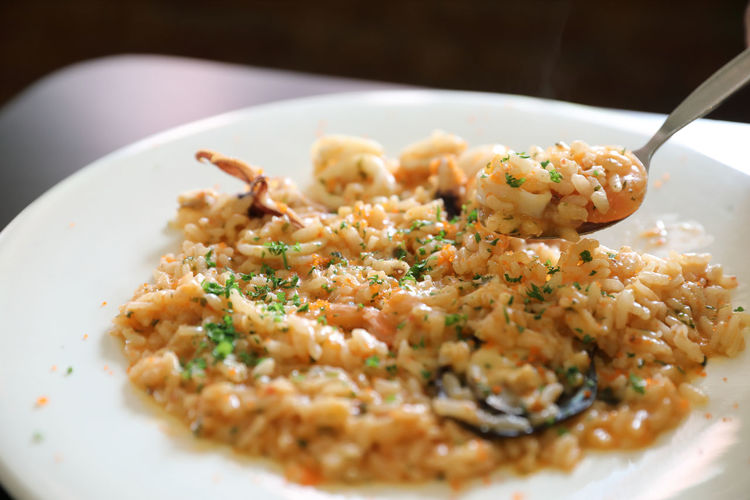 Seafood Risotto Seafood Risotto Ready-to-eat Food And Drink Food Plate Freshness Serving Size Indoors  Kitchen Utensil Wellbeing Eating Utensil Still Life Healthy Eating Spoon Selective Focus Meal Rice - Food Staple Table Indulgence Garnish Dinner Crockery Temptation
