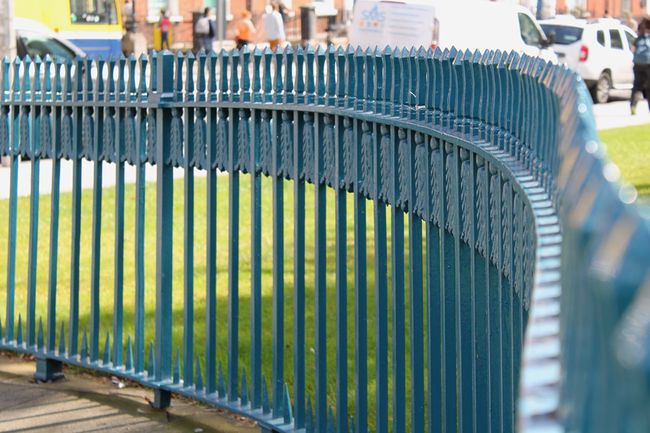 Fence Fences Close-up No People Day Outdoors Green Color Green Grass Prospective Repetition Industry Focus On Foreground Multi Colored Canon Canonphotography Sunshine Dublin Memorial Close Up Backgrounds Focus Shade Spear Summer