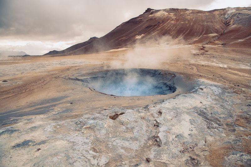 Steam emitting from geyser