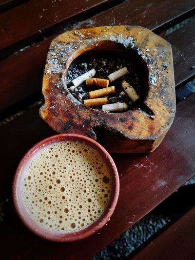 High angle view of cigarette on table