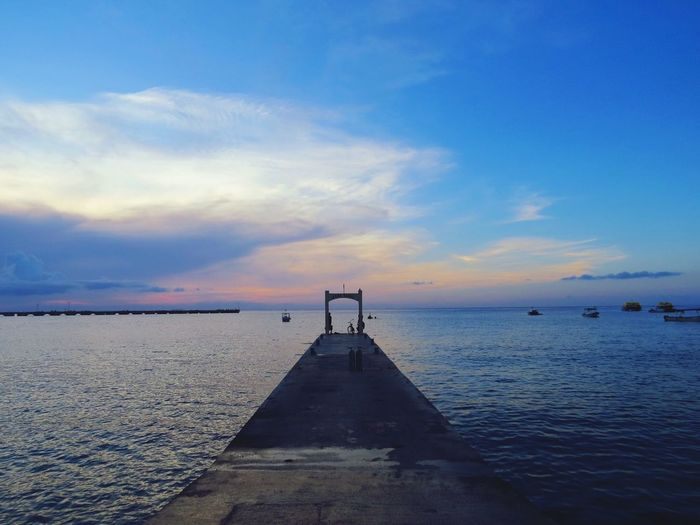 Another beautiful sunset in Cozumel island Water Pier Sea Horizon Over Water Tranquil Scene Tranquility Sunset Sky Scenics Cloud Ocean Calm Rippled Blue Nature The Way Forward Jetty Beauty In Nature Narrow Leading Cozumel Mexico Traveling Cozumelmexico Tourism