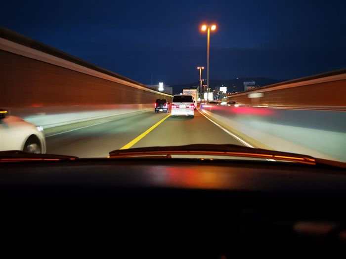 Cars moving on road in city at night