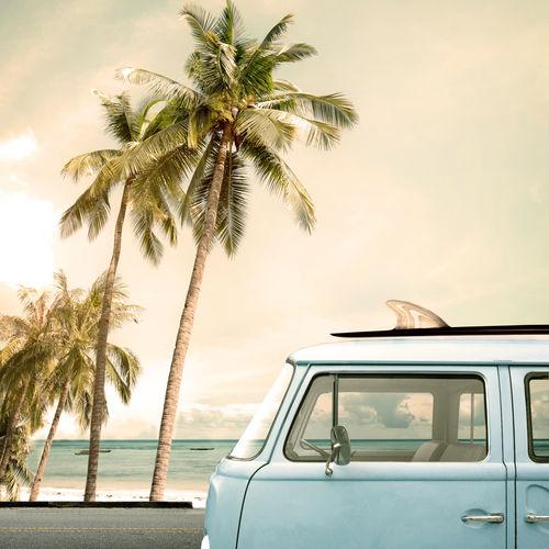 Camper van at beach against sky
