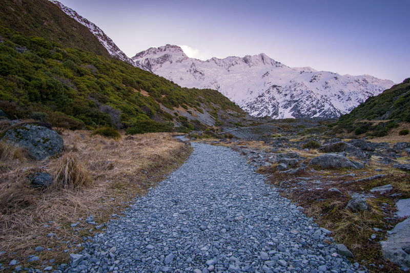Walking trek to Kea Point with awesome scenery Mountain Tranquil Scene Tranquility Mountain Range Scenics - Nature Beauty In Nature Nature Sky No People Landscape Environment Direction Road Non-urban Scene Idyllic The Way Forward Solid Rock Remote Day Outdoors Mountain Peak Snowcapped Mountain