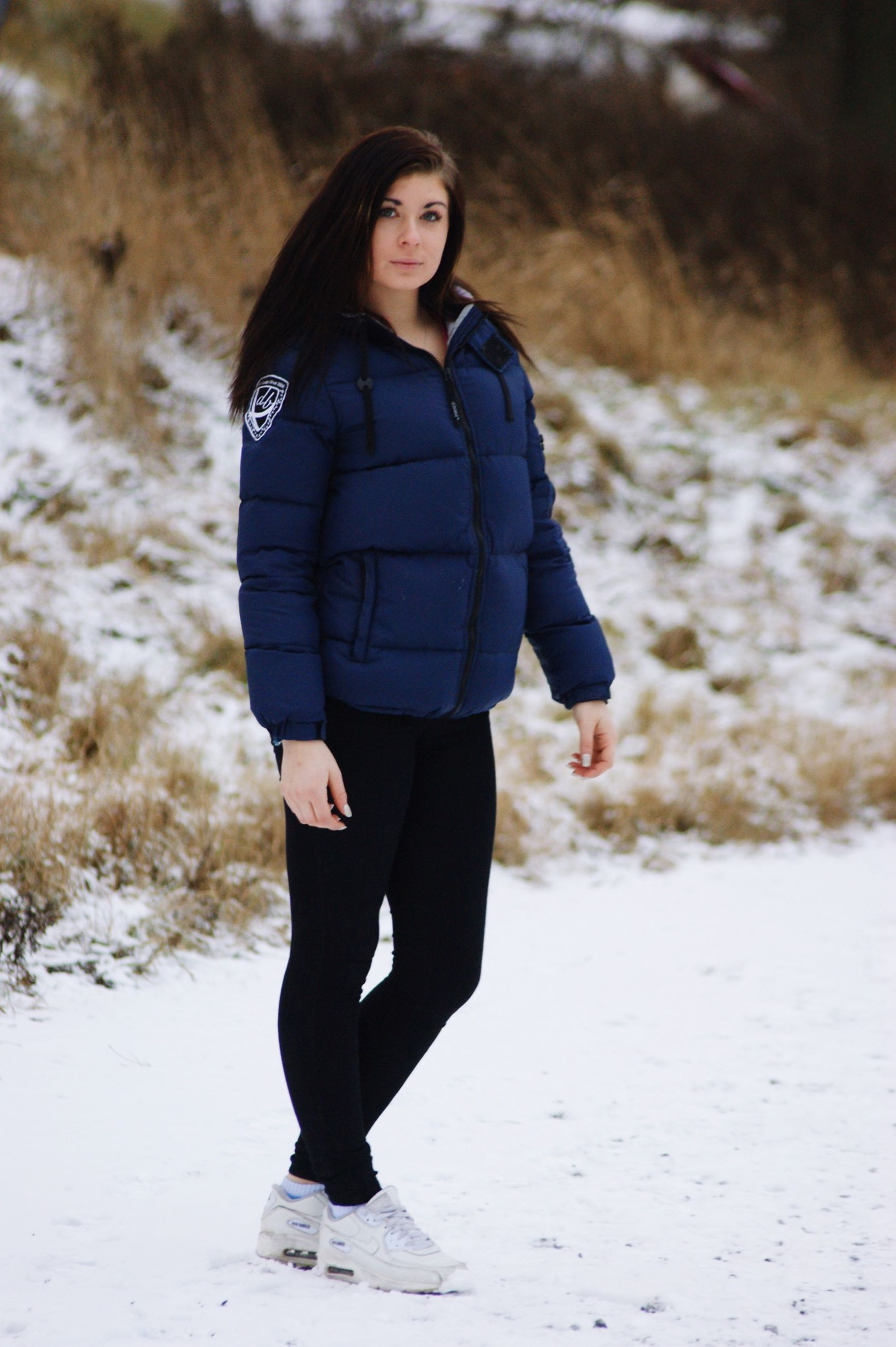 young adult, lifestyles, casual clothing, focus on foreground, standing, front view, looking at camera, leisure activity, full length, portrait, person, young women, walking, winter, warm clothing, snow, jacket, outdoors