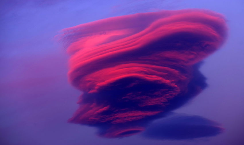 Low angle view of pink cloud against purple sky