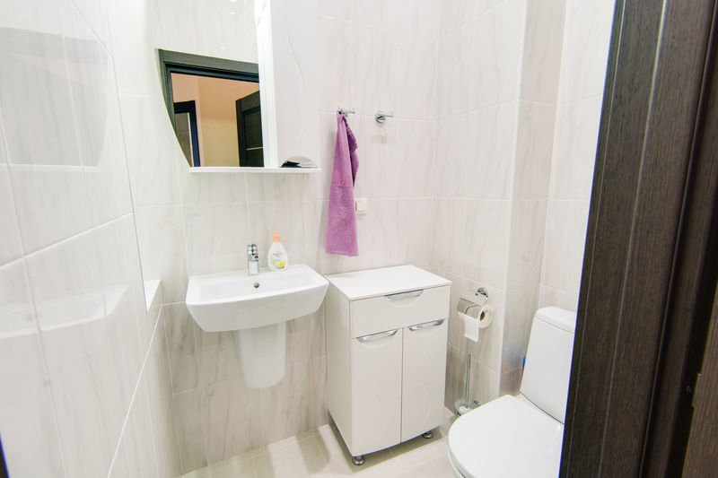 Bathroom Domestic Bathroom Indoors  No People Hygiene Domestic Room Home White Color Curtain Mirror Glass - Material Window Hanging Home Interior Absence Architecture Sink Clothing Pink Color Day Luxury