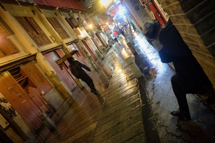 Now You See Me Rain Macao  Street Light Street Photography Streetphotography Night Out Night Nightphotography City Illuminated Architecture Night Built Structure Group Of People Building Exterior Street City Life Wet Men Walking Lifestyles People