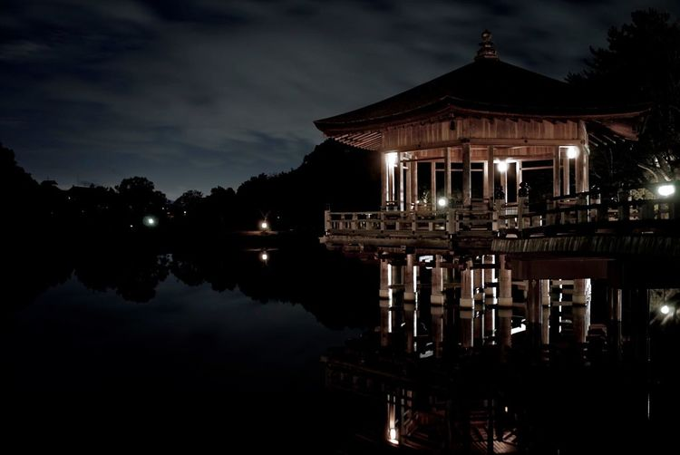 Reflection Of Illuminated Building On Water