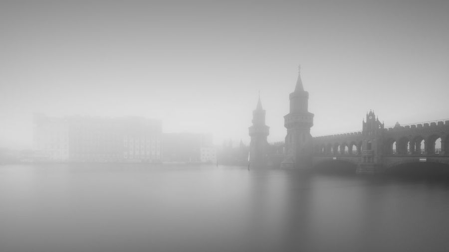 Oberbaum Bridge   Berlin (2017) Architecture Building Exterior City Built Structure Tower Travel Destinations Cityscape River No People Skyscraper Outdoors Sky Day Water Clock Tower Fine Art Photography Berlin Long Exposure Foggy Blackandwhite Black And White EyeEm Best Edits Longexposurephotography EyeEm Best Shots - Black + White Longexpoelite The Week On EyeEm Shades Of Winter The Great Outdoors - 2018 EyeEm Awards