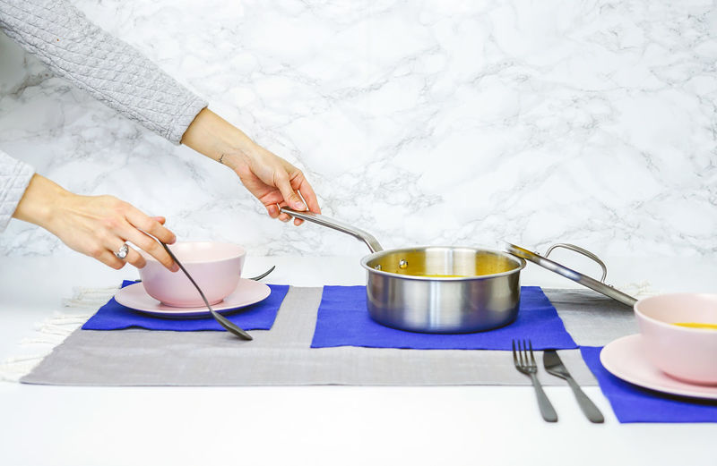 cookware use Human Hand Kitchen Utensil Hand One Person Holding Real People Eating Utensil Table Human Body Part Women Food And Drink Adult Food Spoon Indoors  Preparation  High Angle View Bowl Lifestyles Preparing Food The Foodie - 2019 EyeEm Awards