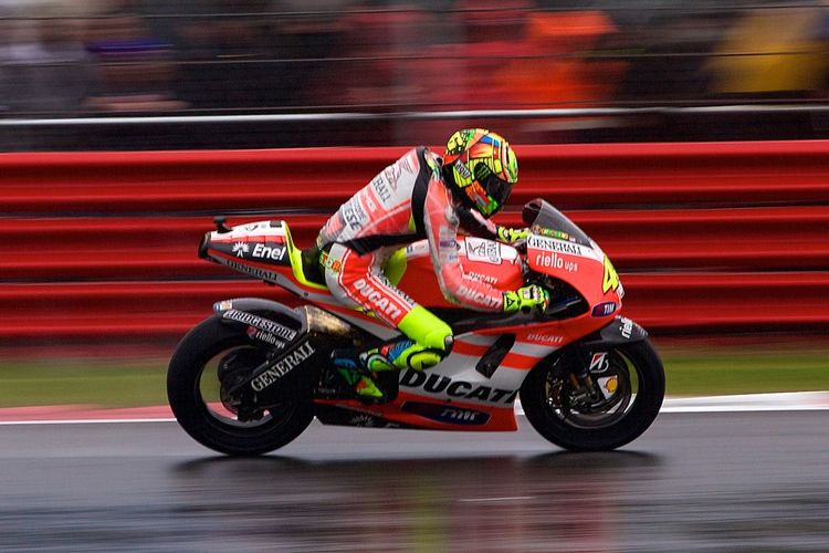 Valentino Rossi. Ducati. Speed Sports Race Motorsport Crash Helmet Motorcycle Sports Track Sports Helmet Sport Motorcycle Racing RISK Motion Helmet Riding Sports Clothing Professional Sport Blurred Motion Skill  Competition Italian Motorcycle Racing