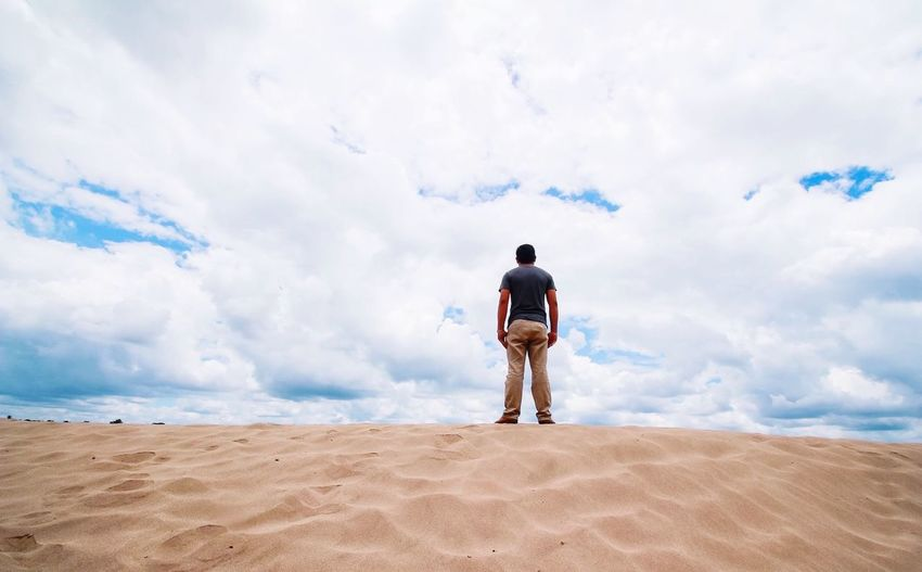 Alone man and sand beach Rear View Full Length One Person Sky One Man Only Cloud - Sky Outdoors Sand Beach Sea Nature Standing Sand And Sky The Secret Spaces The Great Outdoors - 2017 EyeEm Awards Lost In The Landscape