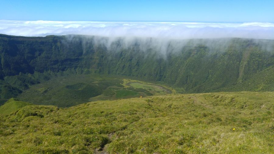 Faial Island Volcano Crater Green Grass Clouds In The Mountian Clouds And Sky Portugal Azores Islands Caldeira