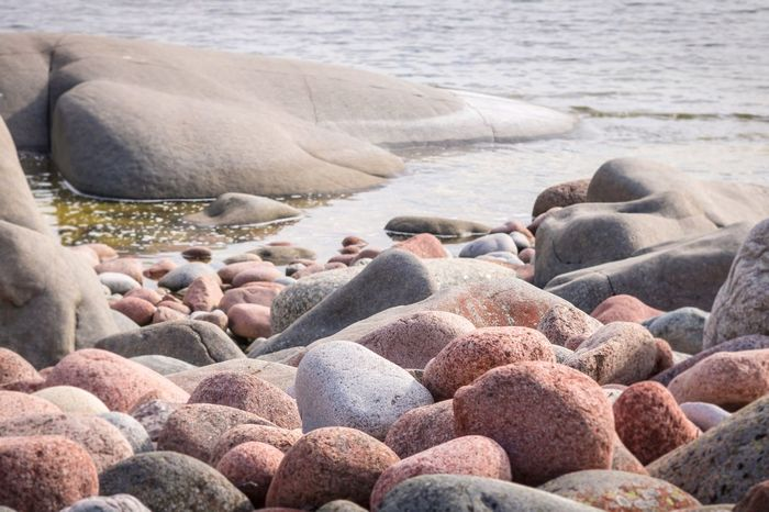 Rocks at Trysunda coast Landscape EyeEm Selects Beach Water Sea Rock Solid Land Nature Stone No People Pebble Rock - Object Day Stone - Object Beauty In Nature Tranquility Tranquil Scene Abundance Sunlight Outdoors