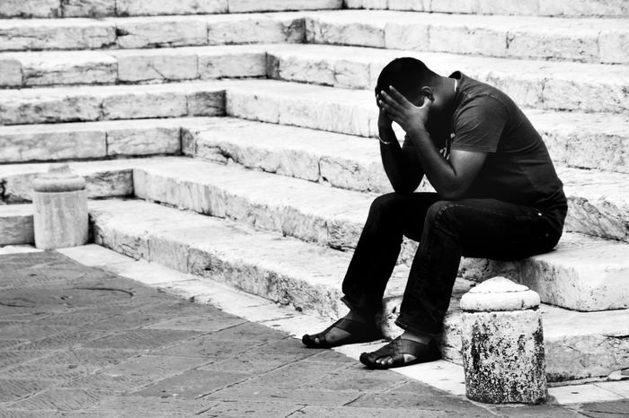 Mass of Black and White Best EyeEm Shot Blackandwhite Brick Wall Candid Portraits Casual Clothing Day Depressed Depression Emotional EyeEm Best Shots Full Length Hat Human Leaning Leisure Activity Lifestyles Outdoors Portrait Seek Shot Sitting Streetphotography