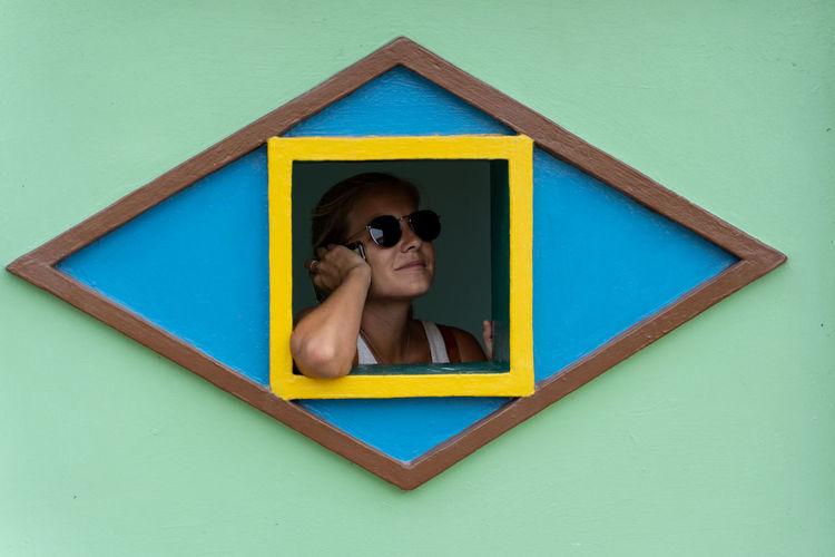 Portrait of boy against blue background