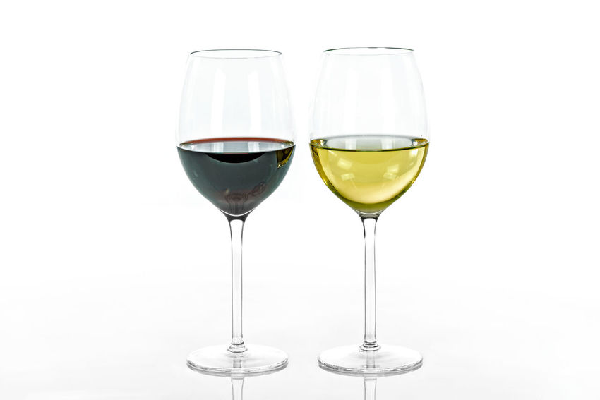 Two types of wine. Red wine and white wine in glasses isolated on white background Alcohol Banquet Bordeaux Cabernetsauvignon Celebration Crystal Diminishing Perspective Drink Drinking Glass Exclusive  Goblet Grapes Lifestyles Merlot Park Red Wine Restaurant Two White Background White Wine Wine Wineglass Winery Winetasting