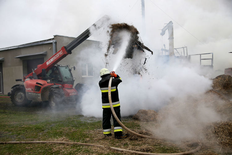 Smoke emitting from fire hydrant at construction site