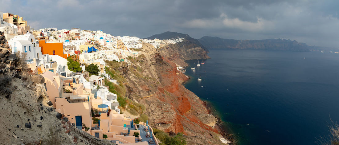 Greece Santorini Oia Thira Architecture Building Exterior Built Structure Water Sea Mountain City Building Residential District Sky Nature Scenics - Nature Day Cloud - Sky Town Beauty In Nature No People High Angle View Land Outdoors TOWNSCAPE
