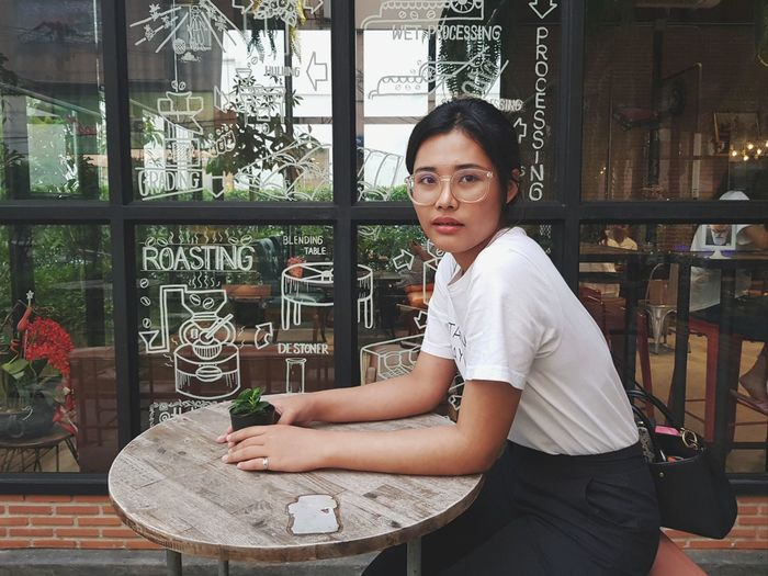 LadiiWarA Portrait Casual Clothing Glasses Girl Coffee Shop Snapshot City Women Business Young Women Beautiful Woman Businesswoman Business Finance And Industry Waist Up Building Exterior Florist Planting Flower Shop Millionnaire