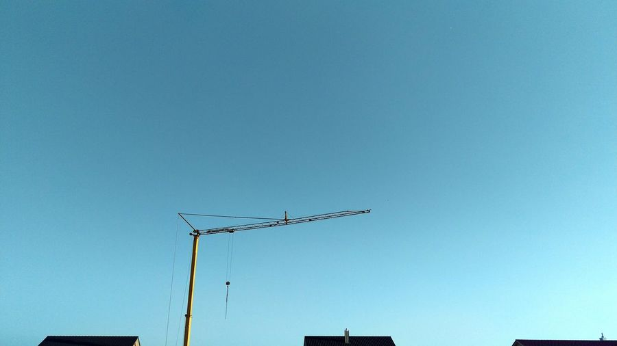 Clear Blue Sky Clear Sky No People Crane Rooftops Cranespotting Houses Chimney