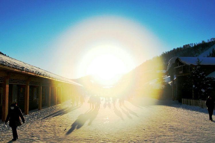 Creative Light And Shadow Sun Sunrise Harbin Snow Village Shot directly towards the sun.
