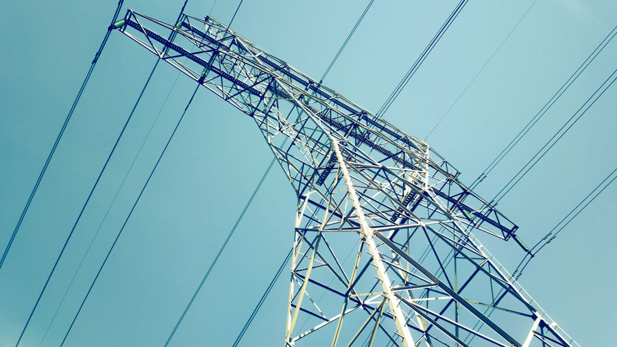 High Section Of Electricity Pylon Against Clear Sky