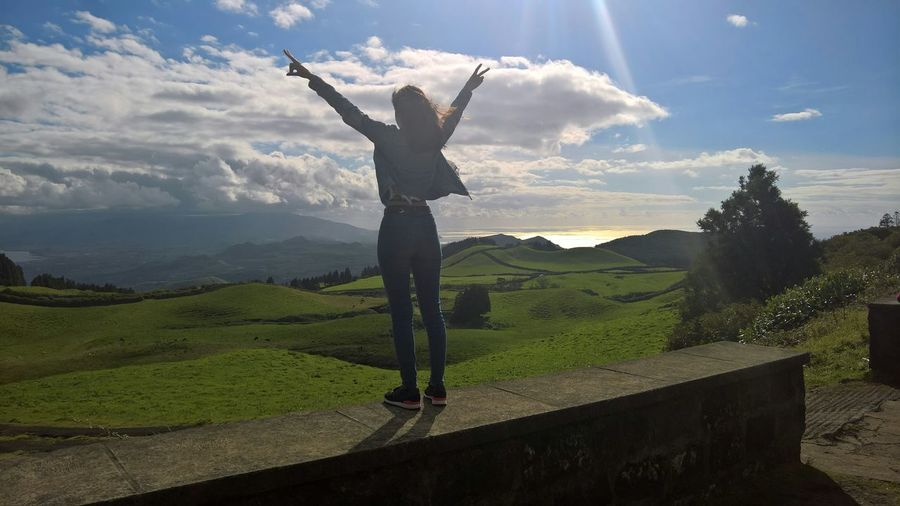 Woman With Arms Raised In Landscape